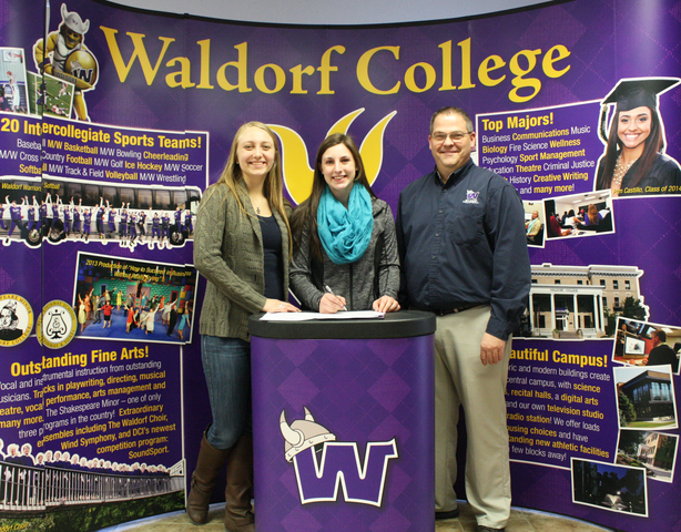 Brielle Wills, a senior at Northeast Range High School in Babbitt, Minn., signed a letter of intent with the Waldorf College volleyball team on Thursday. Pictured from left, Waldorf assistant coach Katie Rueffer, Wills and Waldorf head coach Paul Meyer.