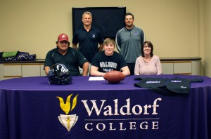 Cale Crowder, a Guthrie Center High School senior, signed letters of intent with the Waldorf College football and baseball teams recently. Pictured in back, from left, Waldorf football coach Kent Anderson and Waldorf baseball coach Joe Tautges. In front, Crowder's father, Gus; Crower and his mother, Angie.